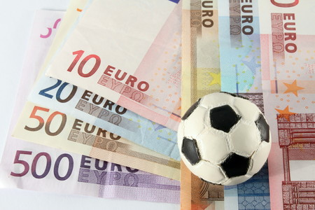 chronicle: Banknotes, euro, as engagement in the sport, use a flask of football. Stock Photo