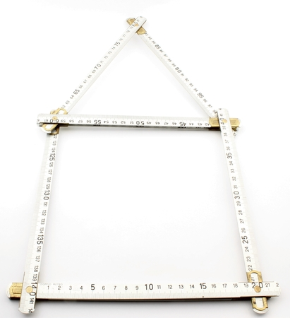 metric: Form of the plane figure, in geometry, constructed with a meter of aluminum in metric measurement of millimeters, of the House Stock Photo