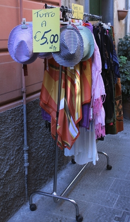 proposed: The proposed sale of womens clothing, on the road Italian.