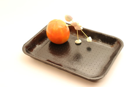 fruit bowl: Tray for food, port puppet fact of candy that pushes food, persimmon.