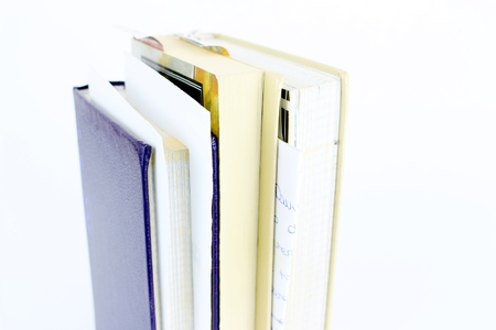 Three books, second hand, with bookmarks in a vertical, white background Standard-Bild