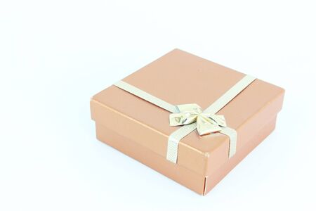 A paper box with a ribbon bow on white background Standard-Bild