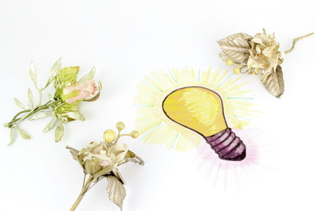 A stylized illustration of a light bulb That Has Been sketched on a sheet of paper. Idea of ??a gift with floral decorations Standard-Bild