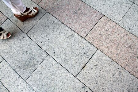 Flooring in a square with big tiles, shoe clear