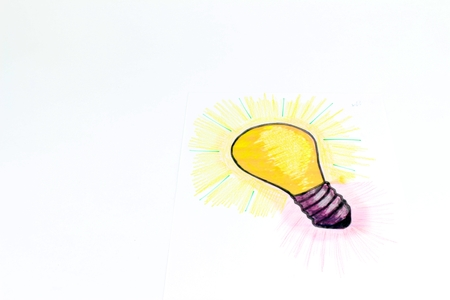A stylised illustration of a light bulb that has been sketched on a sheet of paper. Bright Idea of gift or industry.