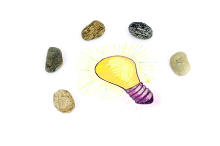 Bright Idea of gift or industry. A stylised illustration of a light bulb that has been sketched on a sheet of paper. Idea of a gift with stones