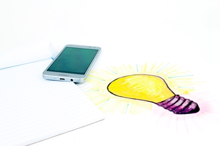 A stylised illustration of a light bulb that has been sketched on a sheet of paper. Bright Idea of industry telephony