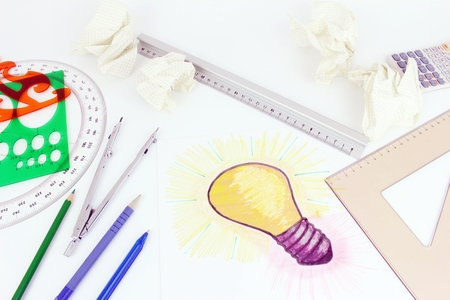 A stylised illustration of a light bulb that has been sketched on a sheet of paper. Idea of a project, drawing objects, of calculation  Error with crumpled up paper.