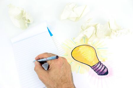A stylized illustration of a light bulb That Has Been sketched on a sheet of paper. Idea of ??a project, drawing objects, calculation of Error with crumpled up paper.