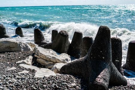 Breakwater at the white rock on the black sea. Abkhazia. Georgia.
