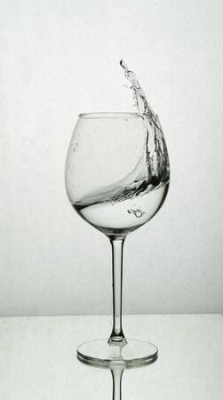 Splash of water in a wine glass