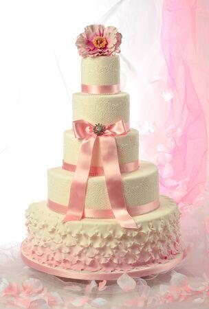 sugar paste: elegant wedding cake with pink ribbon and lace