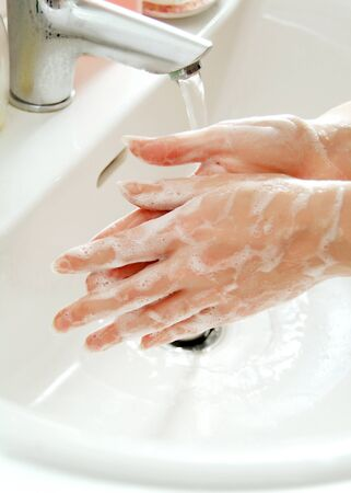 hand rubbing: Wash hands with soap on the sink Stock Photo