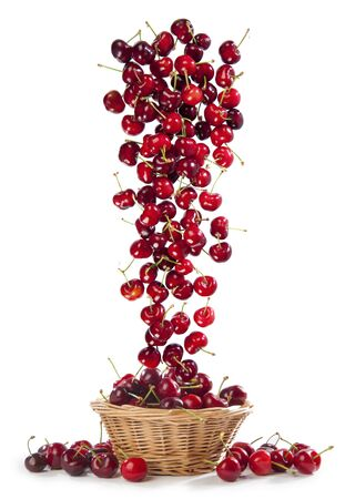 upturned: cascade of cherries in the basket on white background