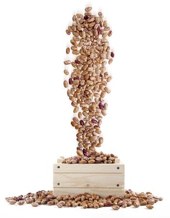 borlotti beans: borlotti beans falling into a wooden box