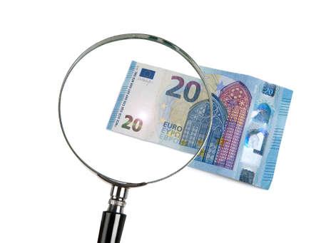 shrinkage: 20 Euro shrunk with magnifying glass Stock Photo