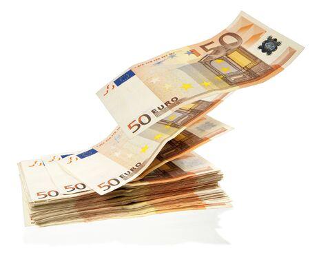 money flying: stack of money flying away