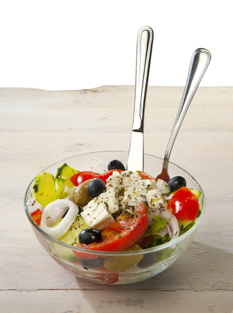 glass bowl: Greek salad in the glass bowl