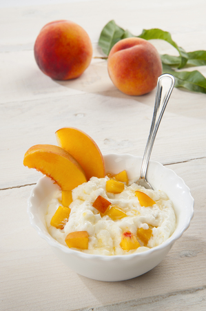 velvety: Bowl with peach mousse with peach background