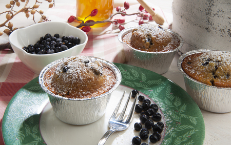 recipe decorated: muffins with yogurt with blueberries on a plate decorated Stock Photo