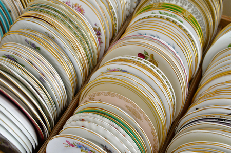 antique dishes: row of antique dishes and vintage decorated