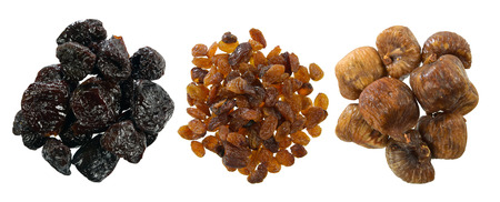dryed: three varieties of dried fruit, figs and sultanas, prunes, on white background