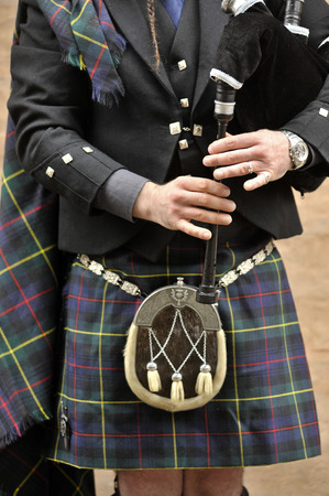 gaita: Scotsman wearing a kilt, traditional Scottish, and playing the bagpipes