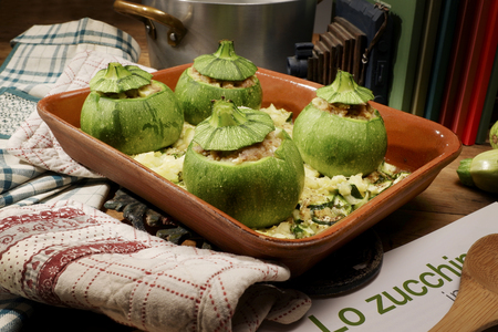 Courgettes stuffed baked inside a earthenware tray Stock Photo