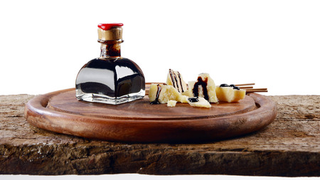 Balsamic vinegar end Parmiggiano Reggiano with white in the background Stock Photo