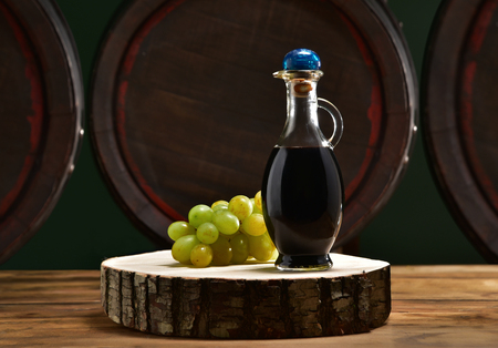 Balsamic vinegar with barrels in the background Stock Photo