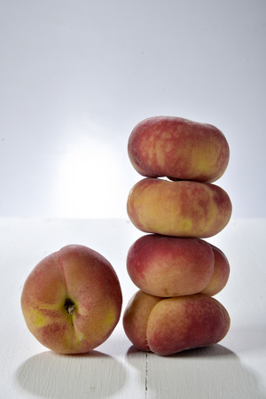 stack of Doughnut peaches photographed do near