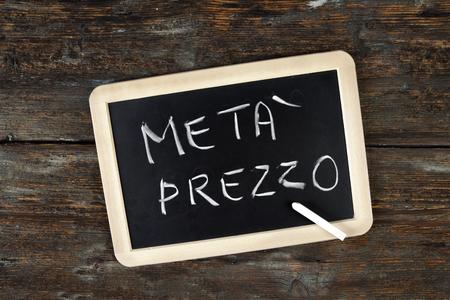 written Price meta on a blackboard with a white chalk