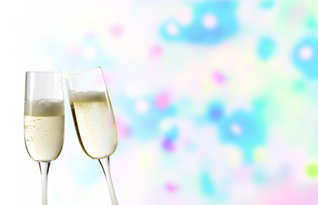 New Years Eve with 2 flutes of sparkling wine and colored background Banco de Imagens