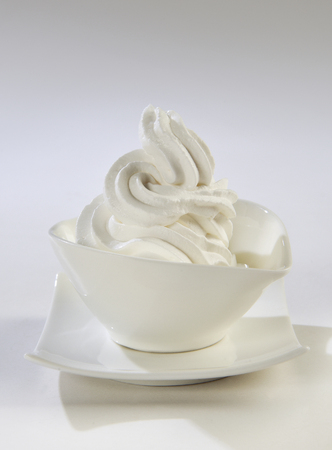 Curl of whipped cream in to a white cup Stok Fotoğraf