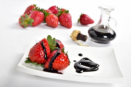 Strawberries with balsamic Modena vinegar on a white plate Stok Fotoğraf