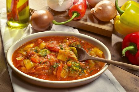 peppers cooked with tomatoes and sliced onions. Archivio Fotografico