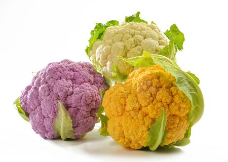 three different color cabbages with a white background