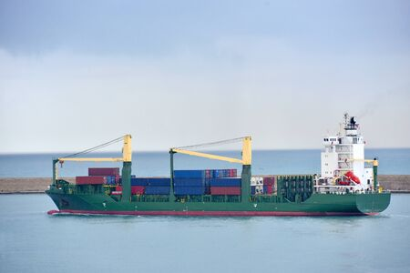 Container ship leaving the dock Stock Photo