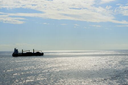 Container ship in the middle of the sea Stock Photo