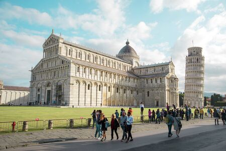 Tourists visiting the City of Pisa with Cathedral and Leaning Tower