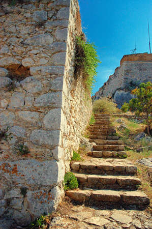 bourtzi: The Palamidi castle Nafplio is a seaport town in the Peloponnese in Greece that has expanded up the hillsides near the north end of the Argolic Gulf