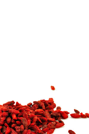 lycium: dried , organic goji berries on a white surface