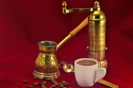 Traditional set for turkish and greek coffee making on a red background photo