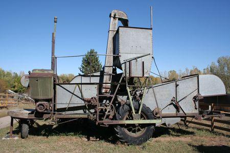 Antique farm machinery; harvester.