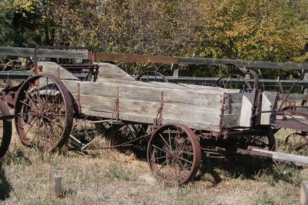 Antique farm machinery; manure spreader.  Wooden spreader with iron wheels.
