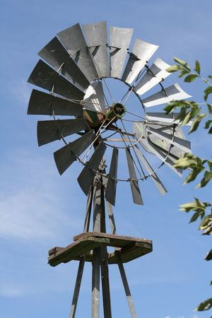 Old farm windmill, symbolizing a return to use of wind power or the prior use of wind power in rural America.