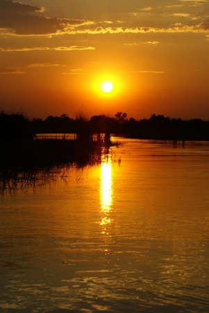 Okavango Delta: Sunset over the Okavango Delta Stock Photo