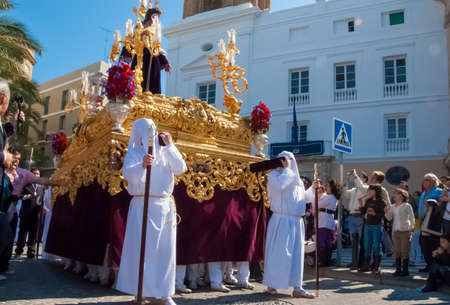sinners: Easter procession during Holy Week in Spain. The float with Jesus figure. Cadiz, Andalucia, Spain