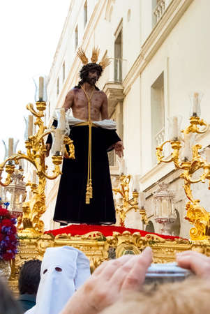 Easter procession during Holy Week in Spain. The float with Jesus figure. Cadiz, Andalucia, Spain