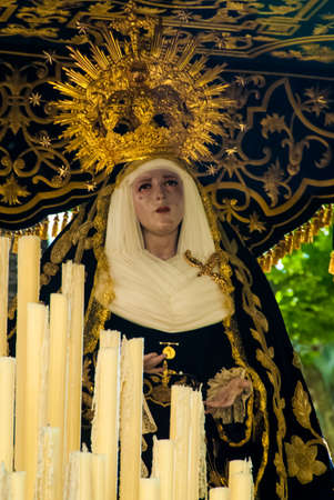 Saint Mary figure on the float in procession during Holy Week in Easter. Seville, Andalucia, Spain.